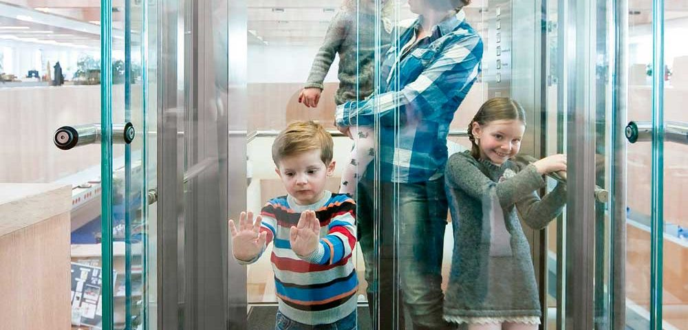 Beware-of-Little-Hands-Getting-Trapped-in-Glass-Lift-Doors