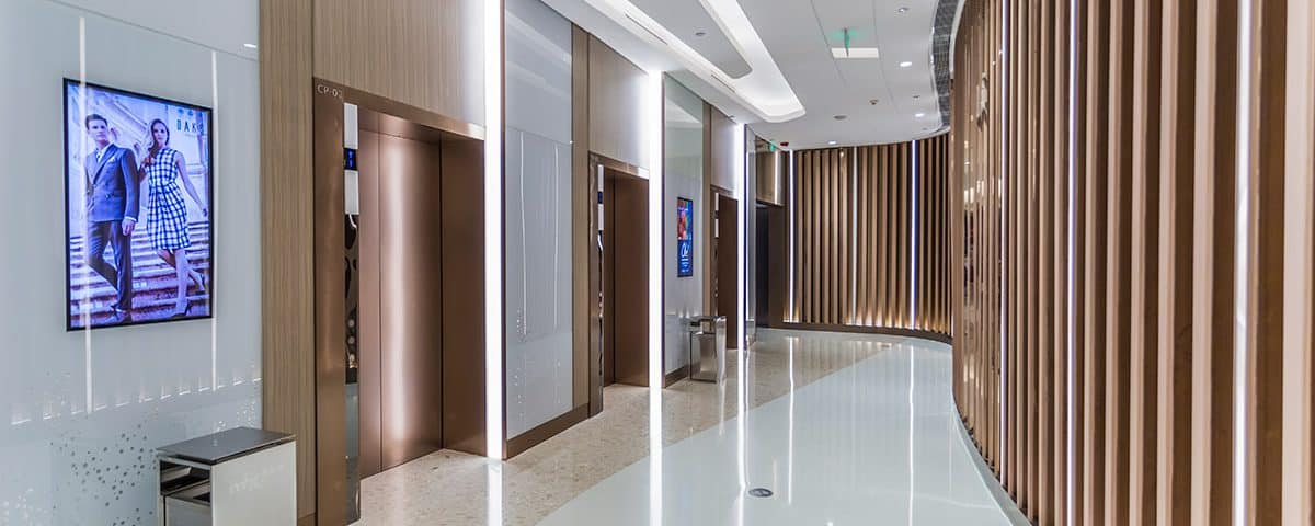 The Use of Lifts in Offices in Social-Distancing Environments