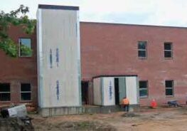 BCI-Construction-To-Build-Glass-Elevator-At-Walkway