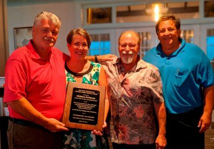Industry-veteran-honored-at-one-golf-tournament-elevator-company-holds-another